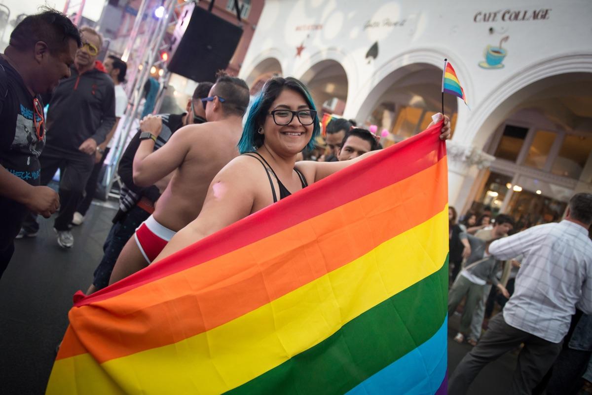 Girl holding Pride Flag at Venice Pride 2017