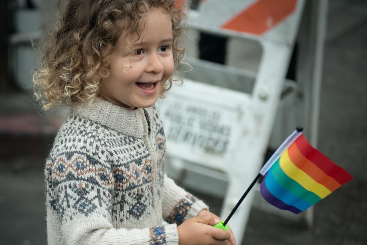 Child holding Pride Flag at Venice Pride 2017